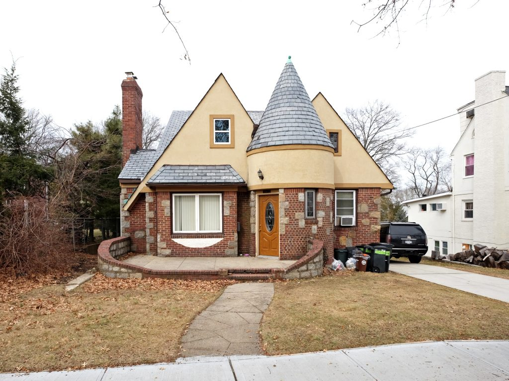 Tiny Tudor with Round Tower and Curved Wall Entry Patio, Jamaica Estates
