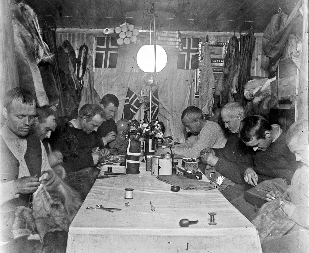 The interior of Framheim during Mid-winter celebrations [Image courtesy of Scott Polar Research Institute]